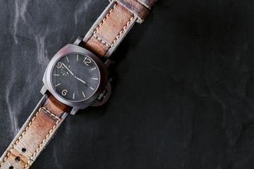 luxury fashion watch on black background