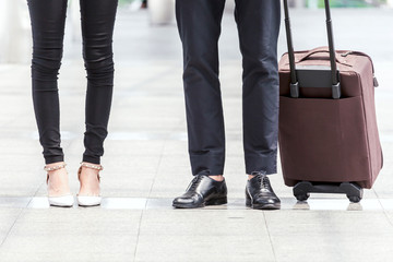 Business people with luggage in the city
