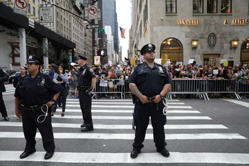 NYPD policemen stand guard as anti-Trump protesters gather in Manhattan in New York
