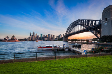 Panoramic view of Sydney Harbour at sunset with the two icons, the Sydney Harbour Bridge and Opera House from North Sydney in Australia