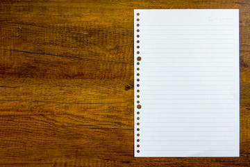 Top view Notebook paper on wooden background. Concept for business and education.