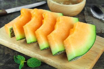 Fresh yellow melon or cantaloupe on white background