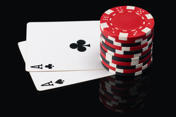 Two aces on poker cards and chip count on them