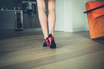 Beautiful woman in heels at home