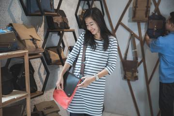 young asian woman at bag store