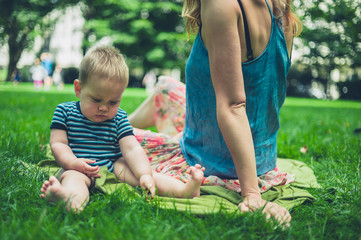 Mother with baby in the park on summer day