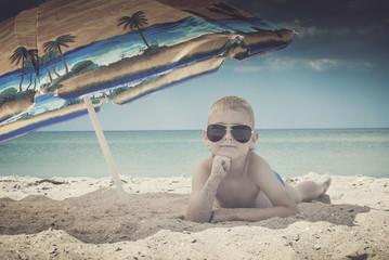 Kid on a sea beach. Instagram stylization