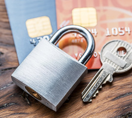 Credit cards and simle mechanical lock.