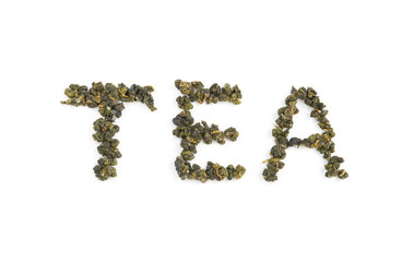 "Fresh Tieguanyin Oolong tea leaves arranged in English letters as ""TEA"" word on white background for hot or cold drinks"
