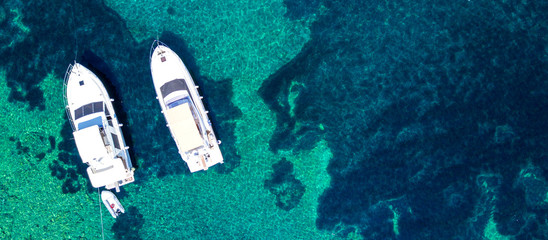 Foto op Textielframe Luchtfoto Aerial view of two yachts and clear turquoise sea