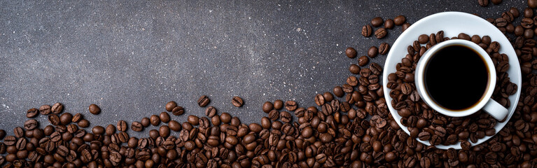 Cup of coffee with roasted coffee beans