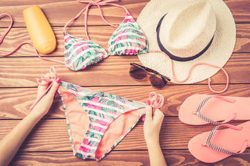 Summer clothing on wooden table