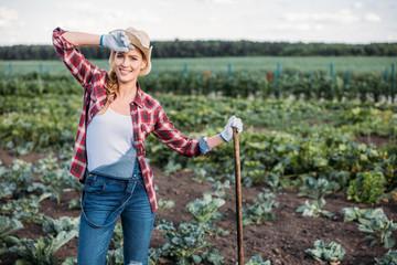 farmer with hoe working in field