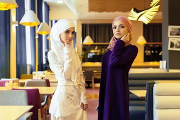 Two beautiful Muslim women in modern oriental clothes