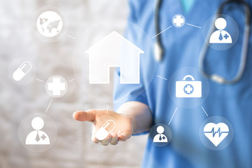 Doctor pushing button house home virtual healthcare network on virtual panel