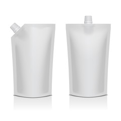 Two white blank plastic stand up pouches with spouts