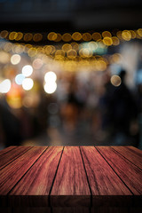 wooden table in front of abstract blurred background of lights