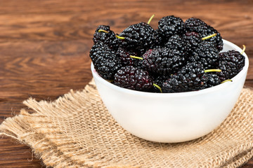 Black mulberries in bowl