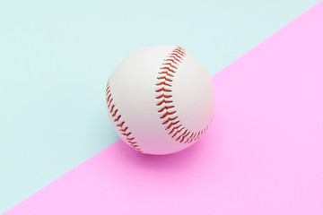 Isolated center baseball on a Pink and Turquoise color background and red stitching baseball. copy space.