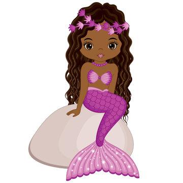 Vector Cute Little Mermaid Sitting on Stone. Vector African American Mermaid