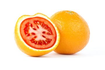Creative photo manipulation of sliced orange with red tomato inside isolated on white background