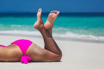 Sexy woman legs in pink bikini