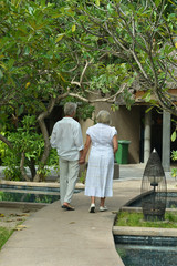 Senior couple near hotel