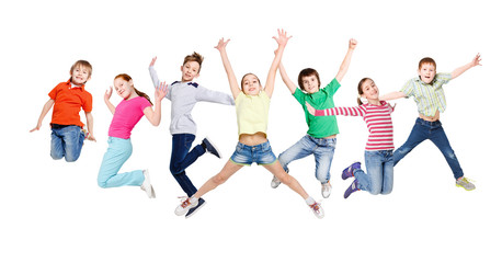 Group of children jumping at white isolated studio background