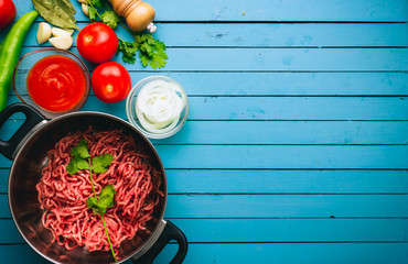 Frame of various vegetables and ingredients to cook ground beef