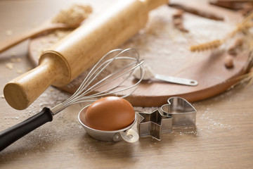 Cake making equipment. wooden rolling pin and Various wooden on brown table