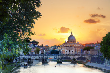 St Peter's Basilica with Tevere River at sunset, Rome, Italy