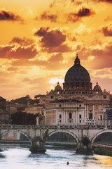 Italy, Rome, St. Peter Basilica at sunset reflecting on Tevere river