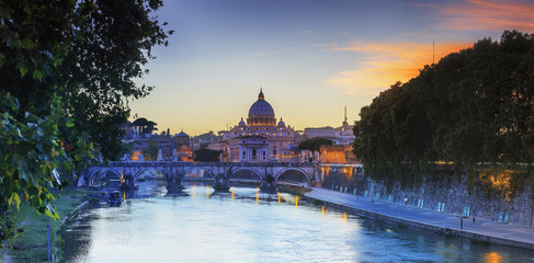 Italy, Rome, St. Peter Basilica by night reflecting on Tevere river