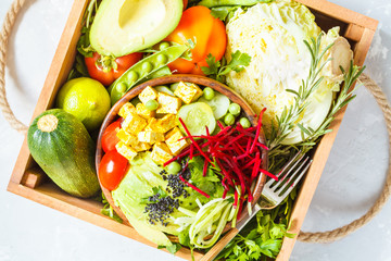 buddha bowl  in wooden box with vegetables