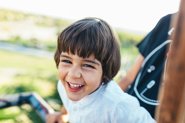 Portrait of a Kid laughing at the Park
