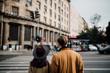 Young couple walking together on the street