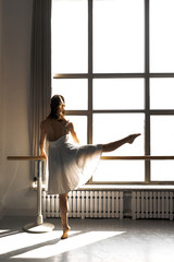 Young professional female dancer practicing in a studio
