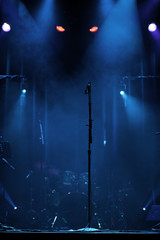 Microphone on stage with creepy lights behind