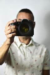 Man taking a photo through camera