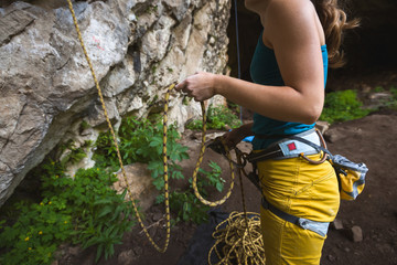 Young woman in colorful clothes belaying