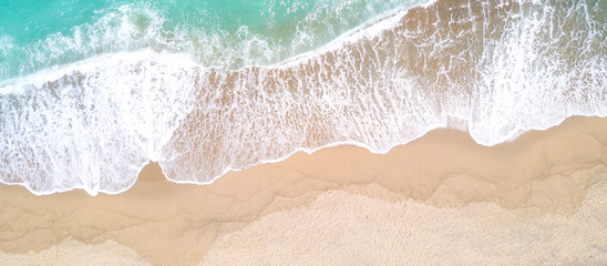 Wall Mural - Aerial view of sandy beach and ocean with waves