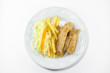 Steak French fries and vegetables