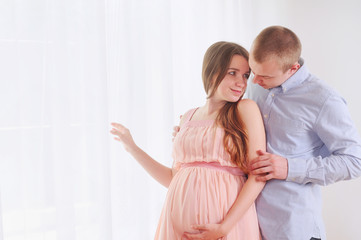 Pregnancy and lovely couple at home
