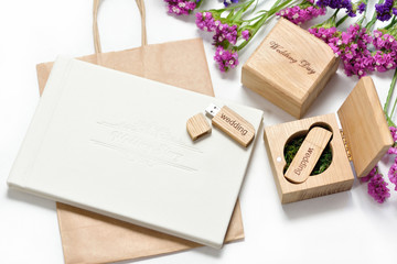 Beautiful white wedding photobook and Usb flash drive in Handmade wooden box. wedding concept