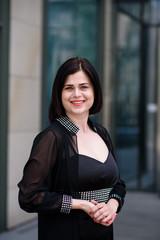 Beautiful business woman in a black dress.