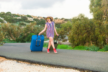 Freedom, travel, vacation and summer concept - Traveler woman with suitcases and laughs outdoors