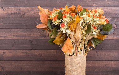 Colorful Autumn Bouquet on a Wooden Background