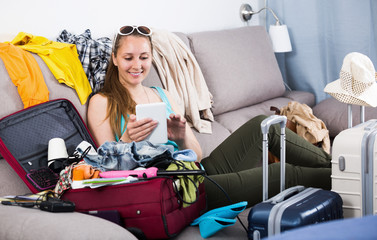 Positive female buying hotel or ticket in internet