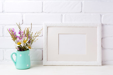 White landscape frame mockup with chamomile and purple flowers in mint green pitcher