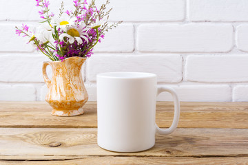 White coffee mug mockup with chamomile and purple flowers in golden pitcher